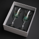 Two hand-painted wine glasses in a decorative hand-made box